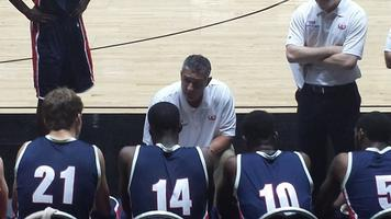 Coach Frank Martin of the University of South Carolina talks to his East Coast All Stars team during a timeout.