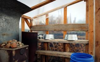 The guesthouse has no running water, but boasts both a tarp and a Finnish sauna in addition to a hot tub.