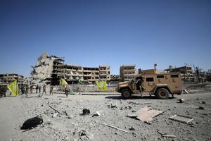 SDF-i võitlejad ISIS-e käest vallutatud Raqqa linnas 17. oktoobril.