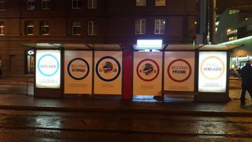 By Monday evening, some of the ads had been pasted over with a sticker stating, 'Different languages, same people.' 7 January 2018.
