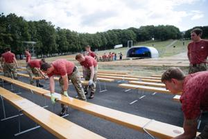 NATO troops are helping set up for the Estonian Song and Dance Festival this week. July 2, 2019.