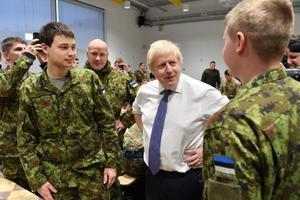 Boris Johnson chatting with Estonian Defence Forces members at Tapa base on Saturday.