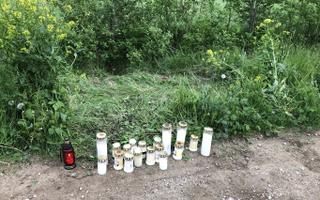 Cemetery candles laid at the scene of Saturday night's deadly shooting near Lihula.