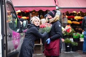 Flower sellers on March 8 by Viru Gate in Tallinn's Old Town.