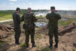 Weapons inspectors from the Russian Federation getting an overview of Exercise Spring Storm.