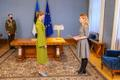 President Kersti Kaljulaid signs the decree giving Reform Party Chairman Kaja Kallas permission to form a government.