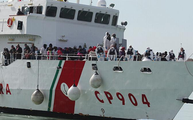 Migrants rescued from the Mediterranean Sea onboard an Italian Coast Guard ship.