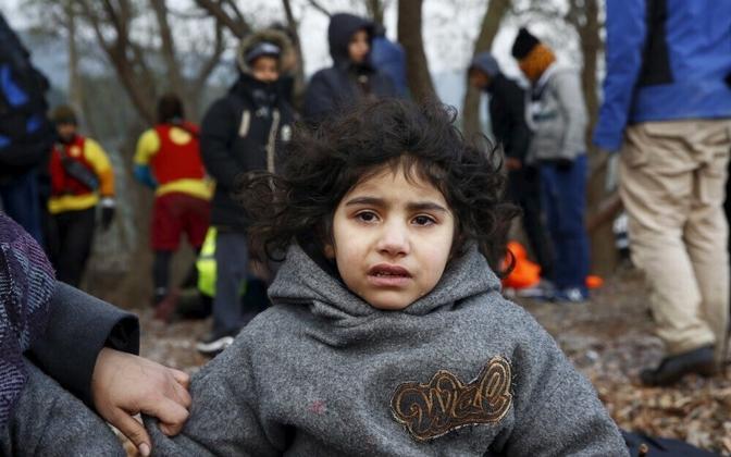 Плачущая иракская девочка на греческом острове, прибывшая на лодке с беженцами 22.01.2016.