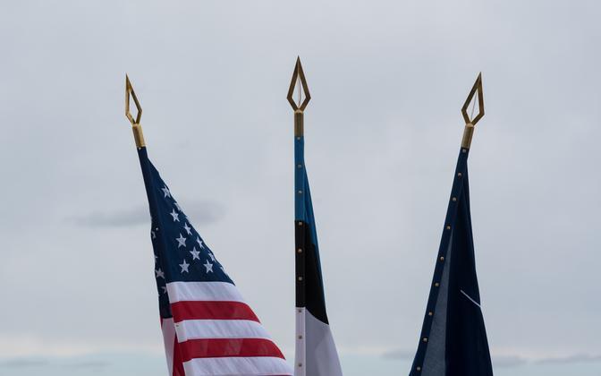 The American, Estonian, and NATO flags.
