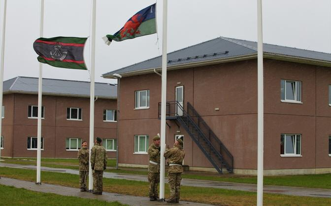 The flag of the 1st Battalion of the Royal Welsh being hoisted at Tapa Army Base on Monday. Oct. 31, 2017.