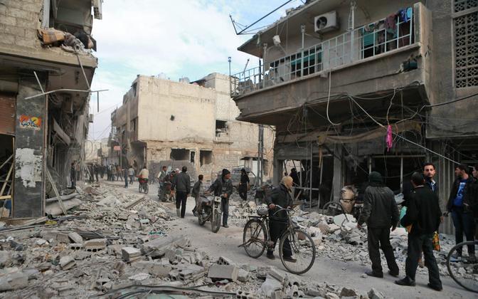 Purustused Süürias Arbini linnas.