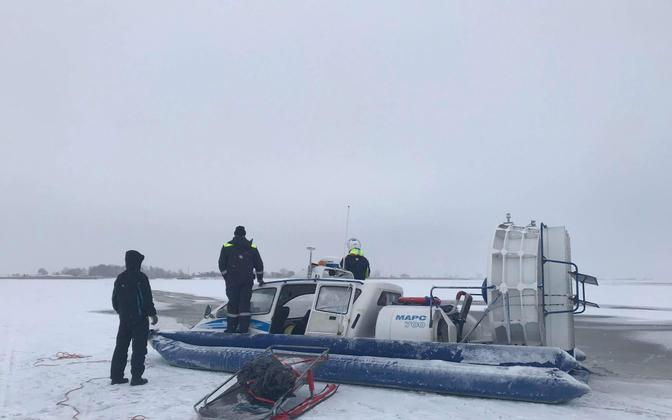 Police photo of a diver at the edge of the ice at the scene of the incident on Tuesday. Feb. 6, 2018.