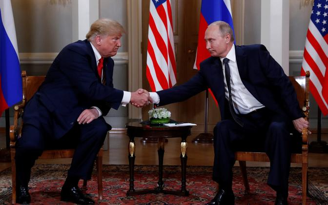 Donald Trump and Vladimir Putin shake hands briefly at the initial meet in front of the cameras.