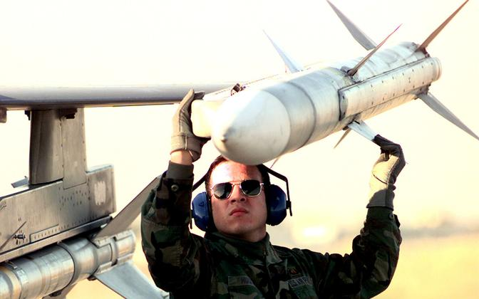 AIM-120 AMRAAM-type missile being loaded onto an F-16 Fighting Falcon. Photo is illustrative.