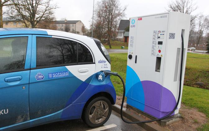 Electric vehicle being charged at the ELMO quick charging station adjacent to the Valga Rimi supermarket.