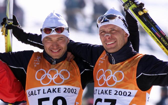 Andrus Veerpaul (left) after clinching his medal at the 2002 Winter Olympics in Salt Lake City, Utah.