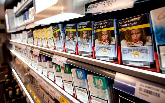 Packs of cigarettes with health warnings displayed at a store.