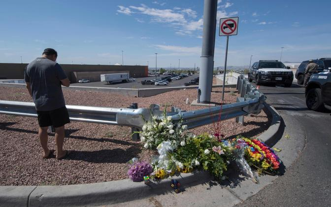 Flowers left at the site of Saturday's mass shooting in El Paso, Texas.