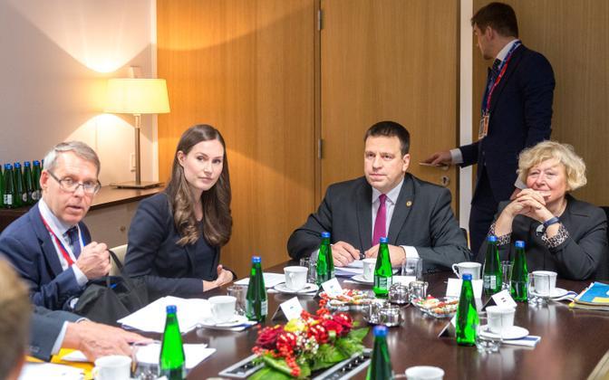 Jüri Ratas sits next to new Finnish Prime Minister Sanna Marin at  meeting in Brussels last week.