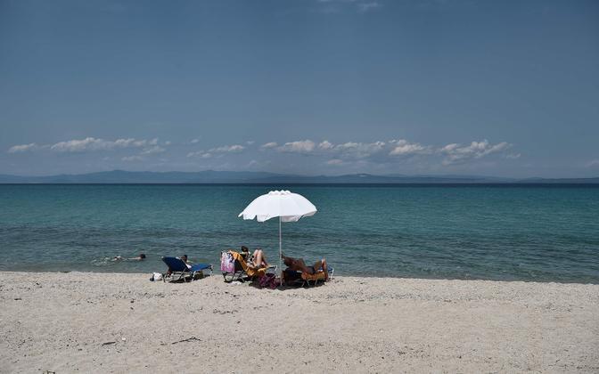 Turistid Kreekas rannas.