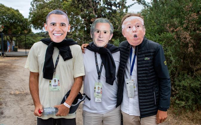 USA presidentide fännid Barack Obama, George W. Bushi ja Donald Trumpi maskides.