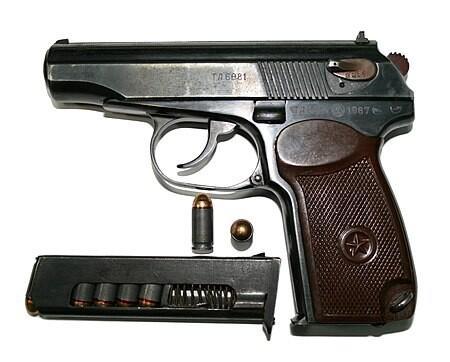 Makarov PM semi-automatic pistol and magazine.