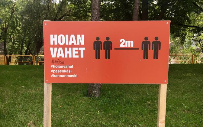 Social distancing sign  by the Emajõgi River in Tartu.