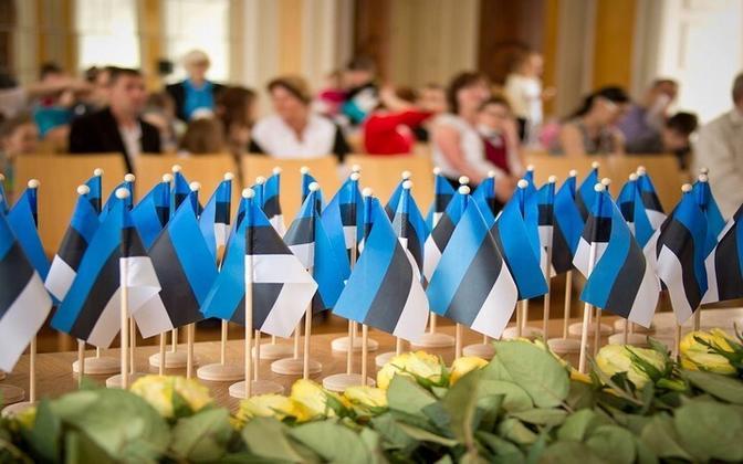 Estonian flags at citizenship receival ceremony.
