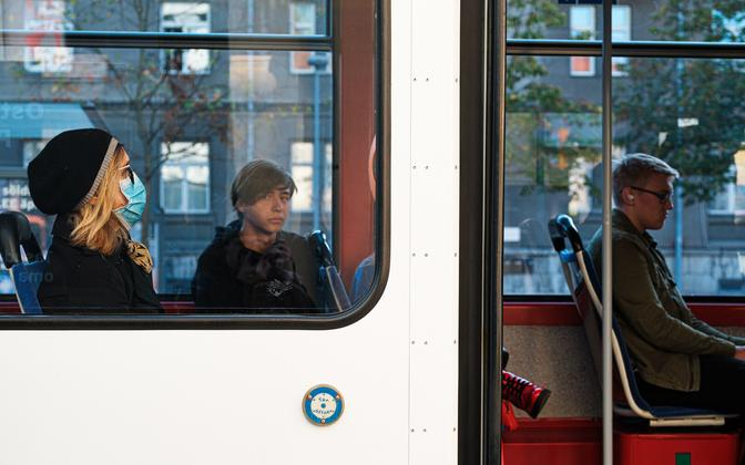 A woman wearing a mask on a tram in Tallinn. Picture is illustrative.