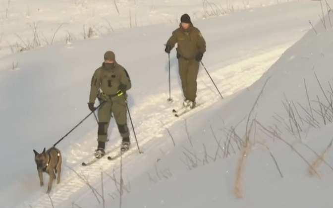 Border guard officers using skis to get around.