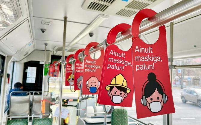 Signs asking passengers to wear masks on a Tallinn bus.