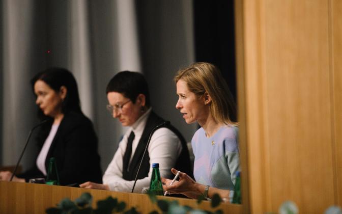 A government press conference in progress.