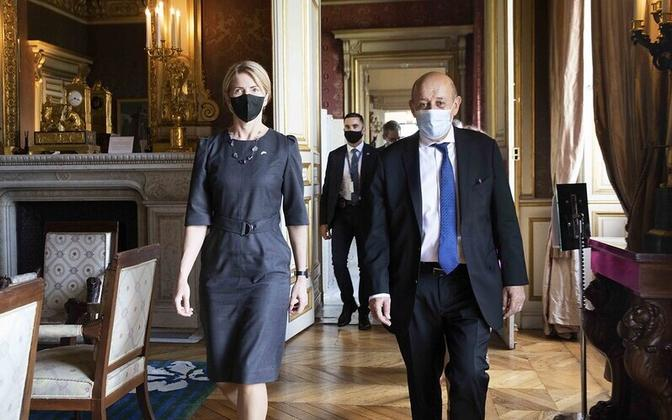 Foreign Minister Liimets has plenty of other countries to deal with and not just Finland and Belarus - here she is pictured with French counterpart Jean-Yves Le Drian at a meeting Wednesday where the pair signed a strategic partnership.