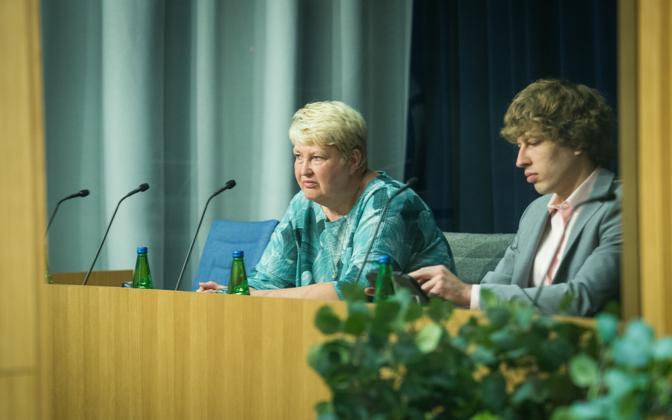 Marika Priske with Tanel Kiik at a press conference Monday.