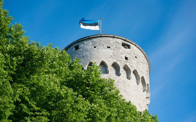 Estonian blue-black-white flag atop Pikk Hermann tower in Tallinn.