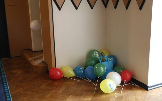 Balloons in the various party political colors, stacked up in a corner of the Riigikogu building.
