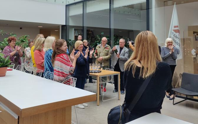 Alar Karis' colleagues at the Estonian National Museum in Tartu celebrate his election has head of state Monday, August 31 2021.