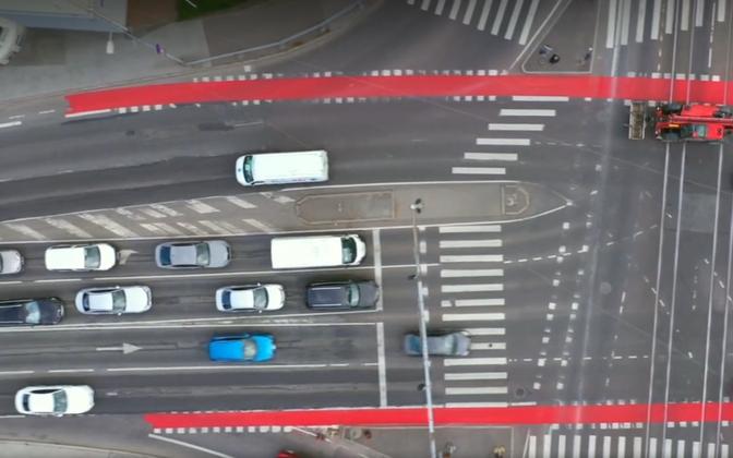 Red cycle lanes in Tallinn traffic.