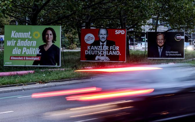 Valimisplakatid Berliinis, kus on järjest Annalena Baerbock (Rohelised), Olaf Scholz (Sotsiaaldemokraatlik Partei) ja Armin Laschet (Kristlik Demokraatlik Liit).